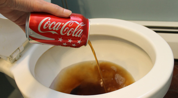 She-Poured-Some-Coke-Drink-Into-The-Toilet