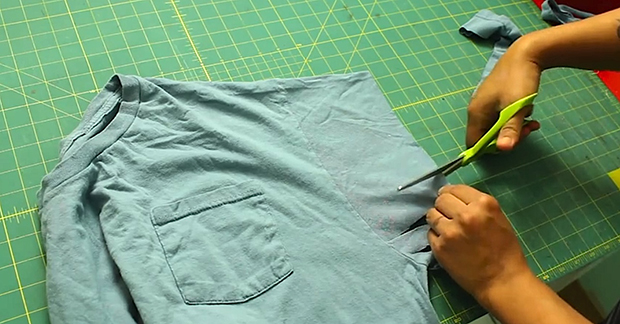 She Cuts Into The Sleeve Of Her Old T-Shirt