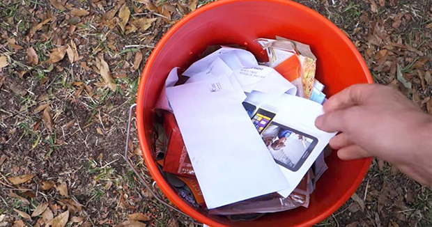 This Guy Soaks The Junk Mails IntoA Container With Water